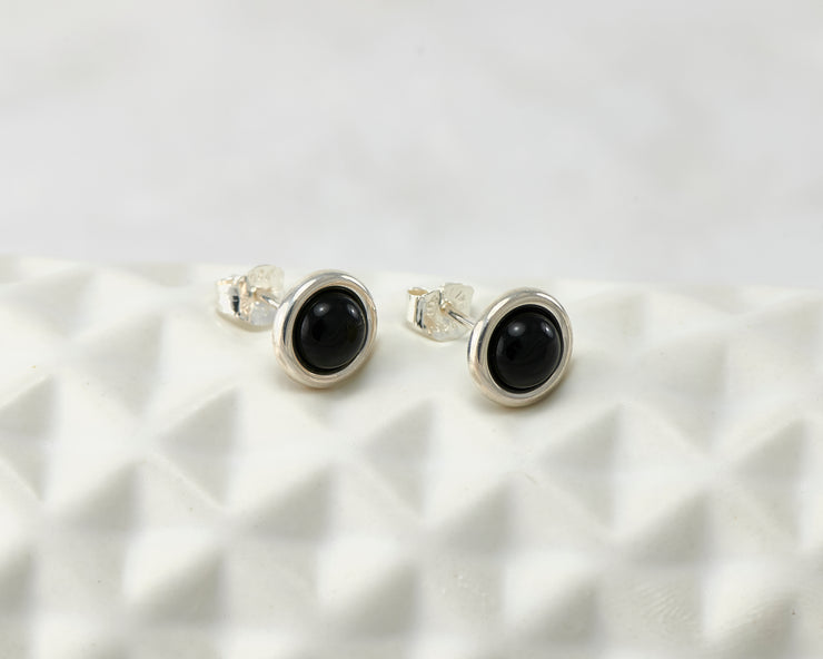 silver black onyx stud earrings on geometric vase