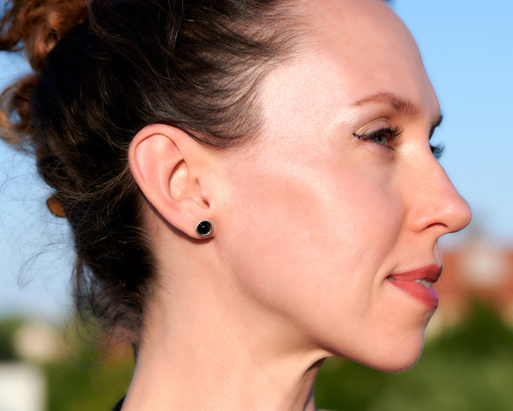 woman wearing silver black onyx stud earrings