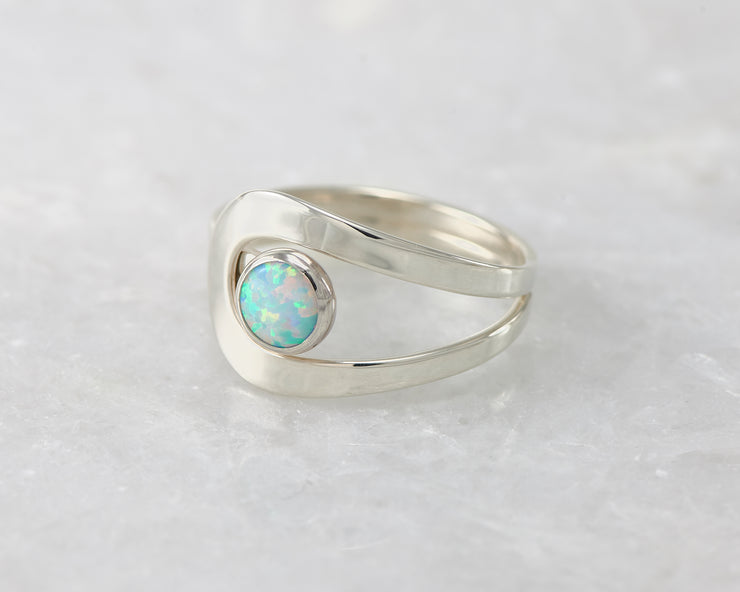 wrap blue opal ring on white marble