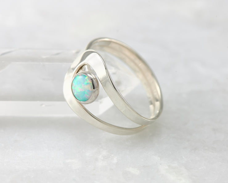 blue opal Silver ring leaning on crystal