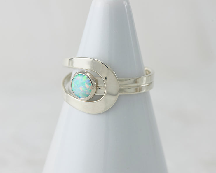 White ring holder with blue opal Silver ring