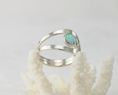 Silver blue opal ring on coral