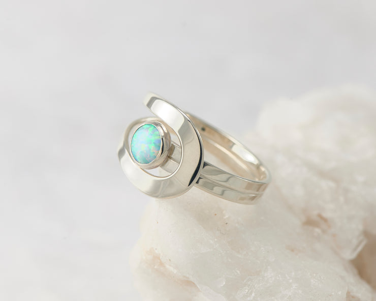 Silver blue opal wrap ring on white rock