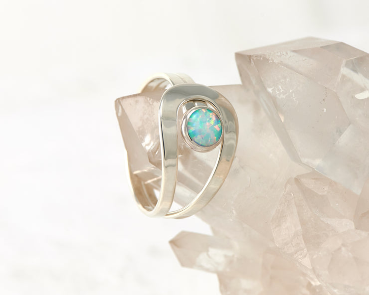 blue opal wrap ring on crystal rock