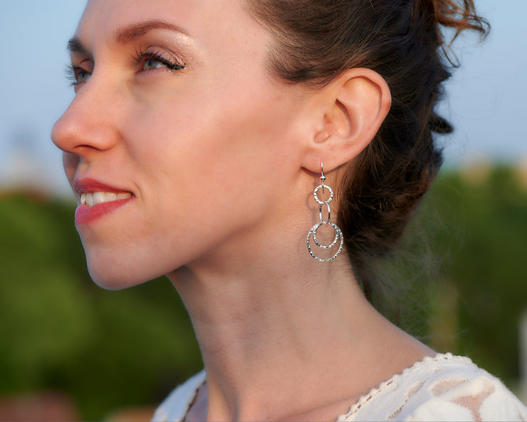 Woman wearing silver hammered circles earrings