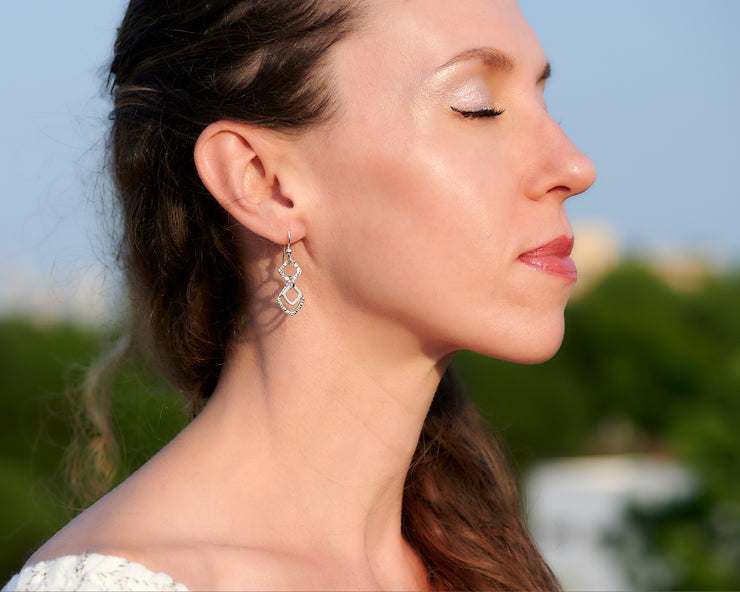 Woman wearing silver hammered squares earrings