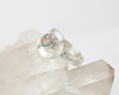 fire opal wrap ring on crystal rock