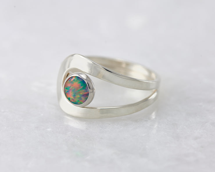 wrap fire opal ring on white marble