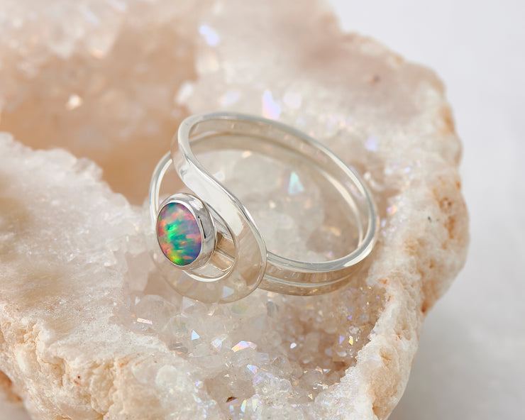 fire opal silver wrap ring on quartz