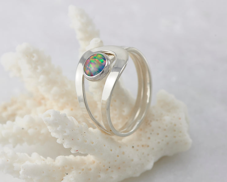 Silver fire opal ring on coral