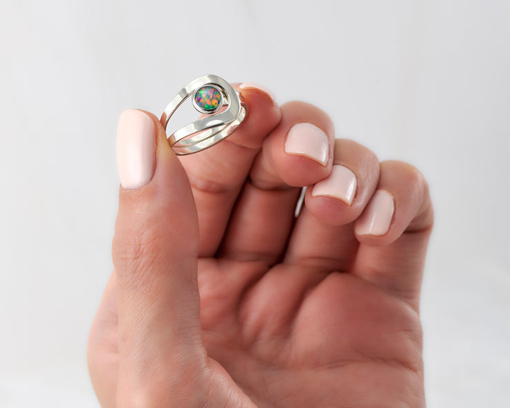 Woman holding fire opal silver ring