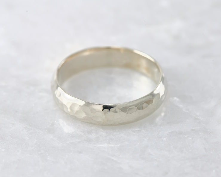 simple hammered ring on white marble