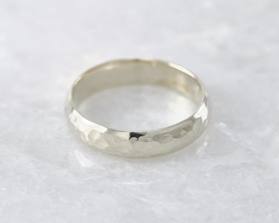 wedding ring laying on white marble