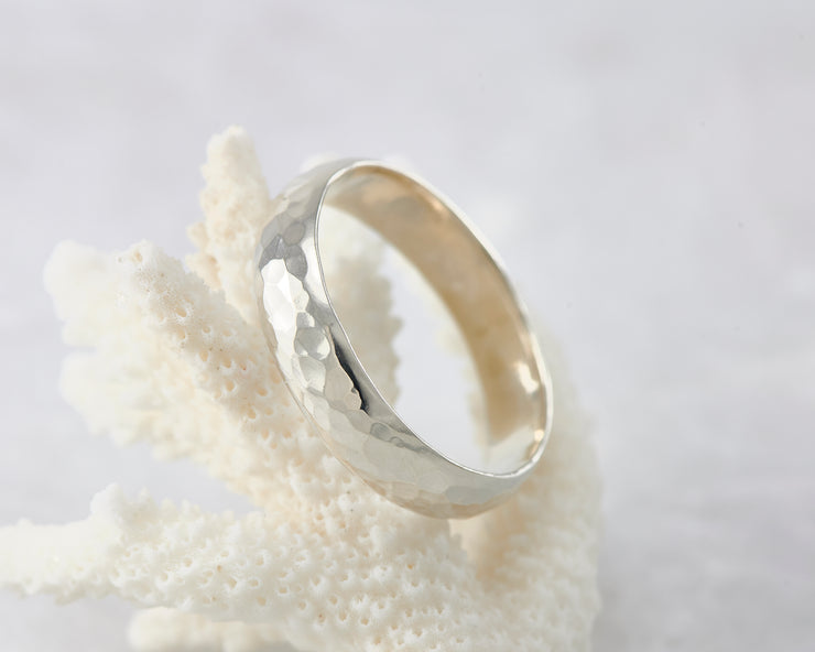 Silver hammered ring on coral
