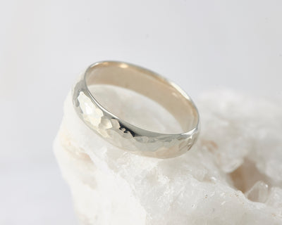 Silver hammered simple ring on white rock