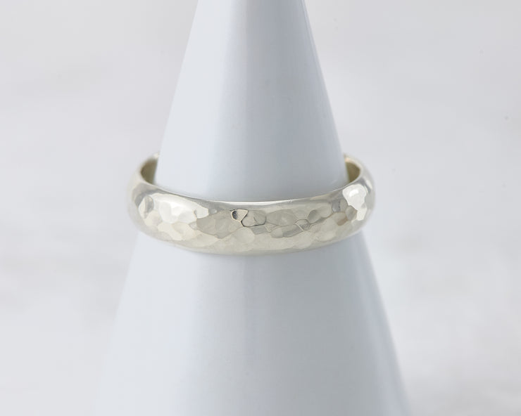 simple hammered ring on white ring holder
