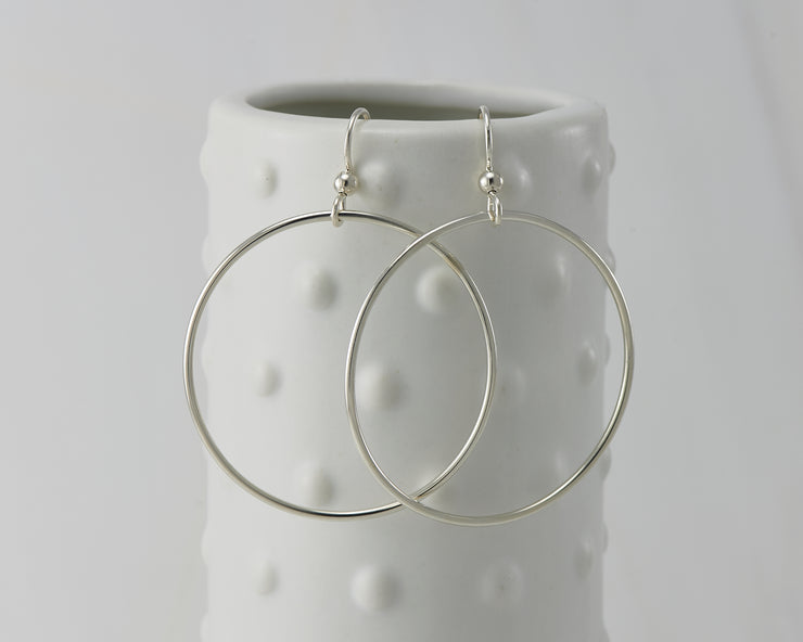 silver large hoop earrings on dotted vase