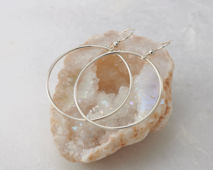 silver large hoop earrings on quartz