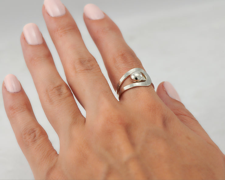 Woman wearing wrap modern ring