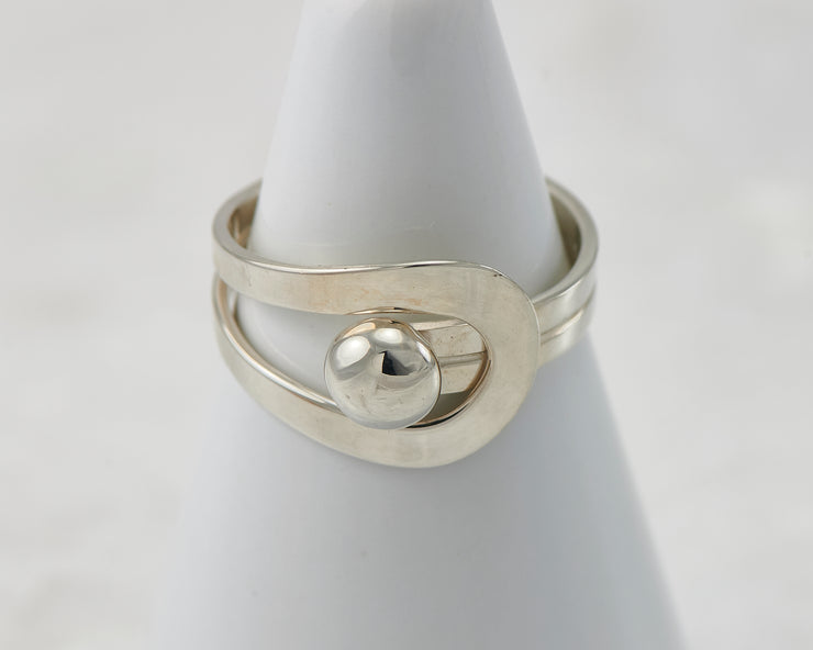 White ring holder with modern Silver ring