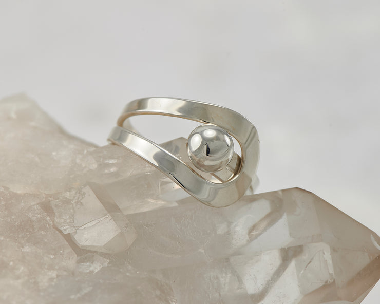 Silver wrap ring on crystal rock