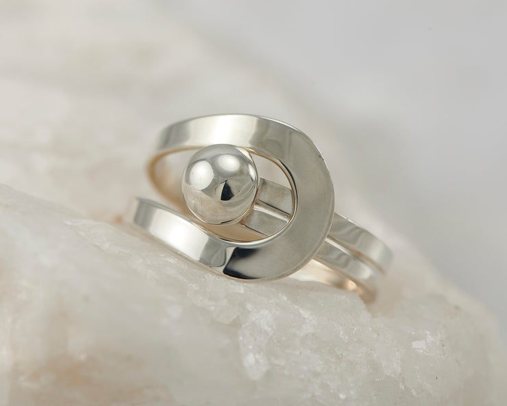 Silver modern wrap ring on white rock