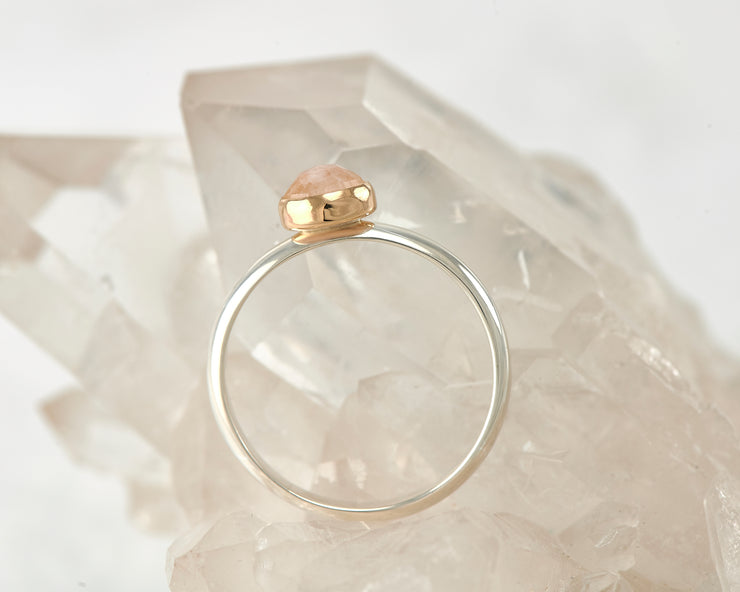 silver and gold moonstone engagement ring on crystal rock