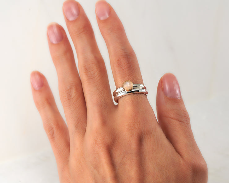 woman wearing moonstone engagement ring & matching wedding ring