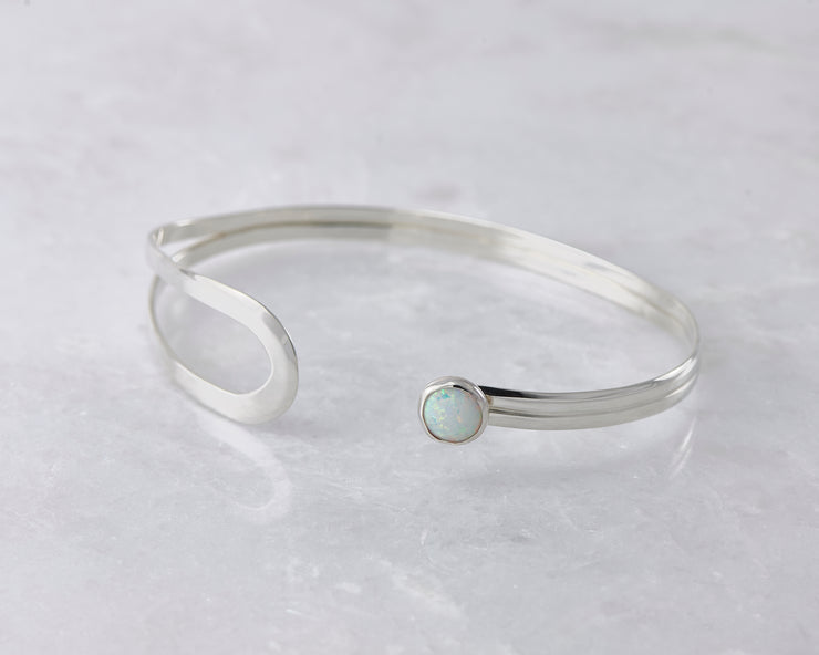 latch style opal silver bracelet open on marble