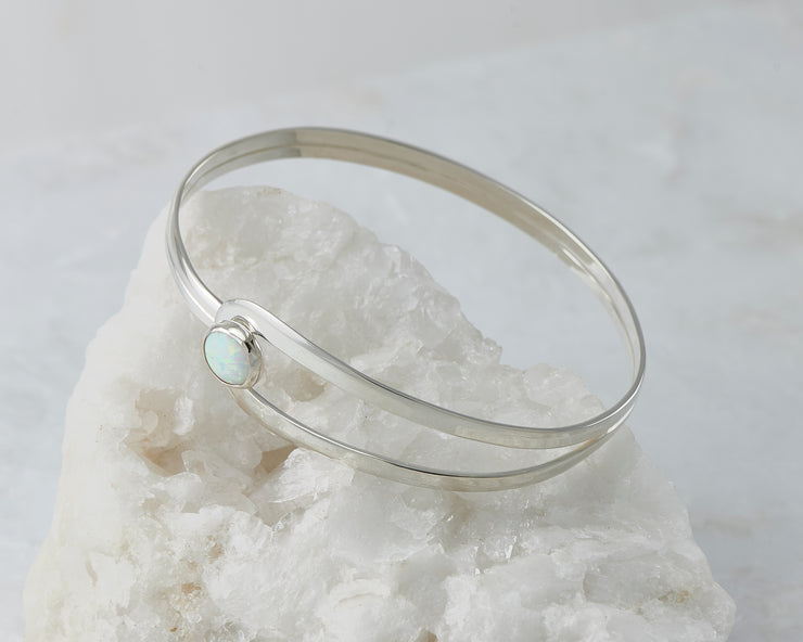 Silver Opal Bracelet on white rock