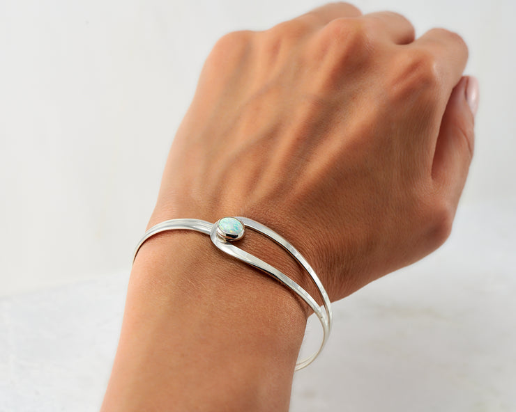Woman wearing silver opal latch bracelet