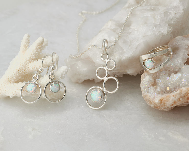 opal jewelry set with earrings, necklace, and ring