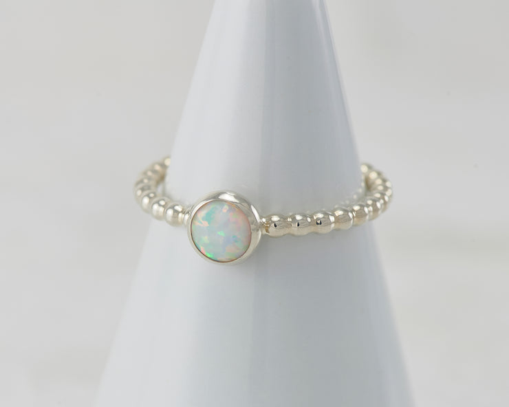 White ring holder with opal Silver ring