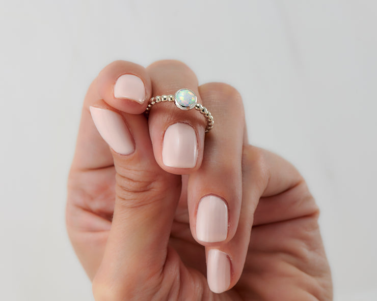 Woman holding opal silver ring