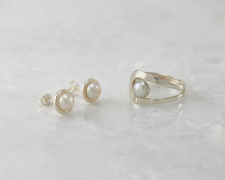 pearl stud earrings and matching pearl ring