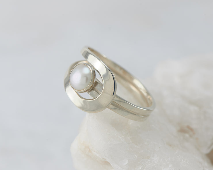 Silver pearl wrap ring on white rock