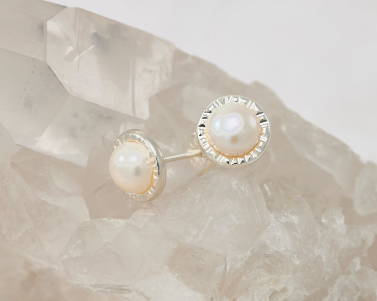 silver pearl stud earrings on crystal