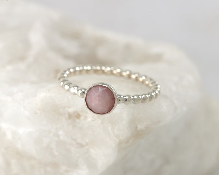Silver peruvian pink opal beaded ring on white rock