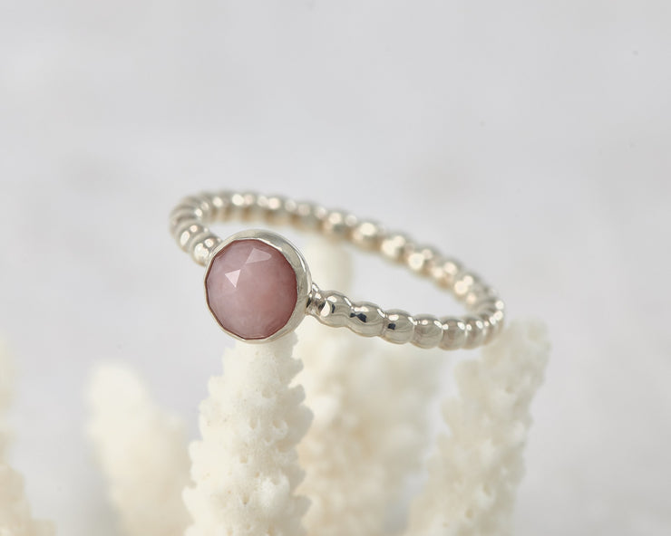 Silver peruvian pink opal ring on coral