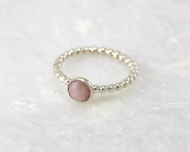 beaded peruvian pink opal ring on white marble