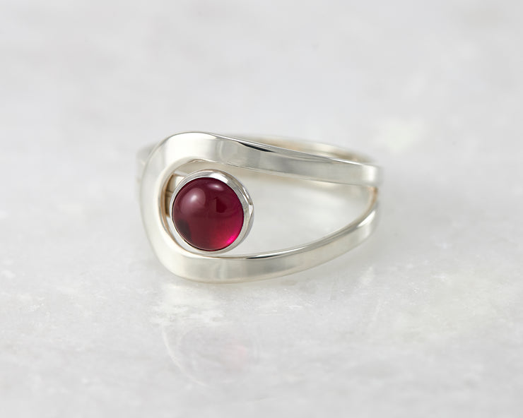 wrap ruby ring on white marble