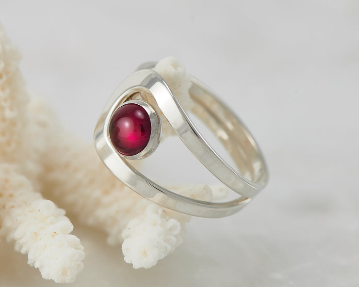 Silver ruby ring on coral