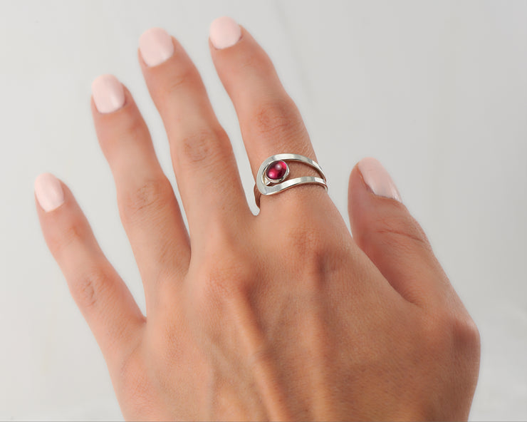 Woman wearing wrap ruby ring