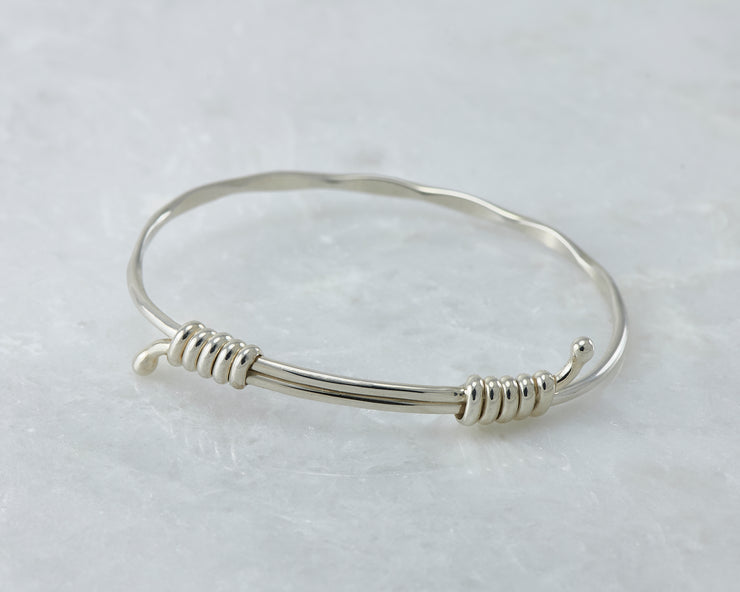 bangle bracelet adjustable silver shown closed on marble