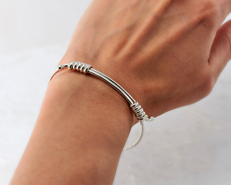 Woman wearing adjustable silver bracelet