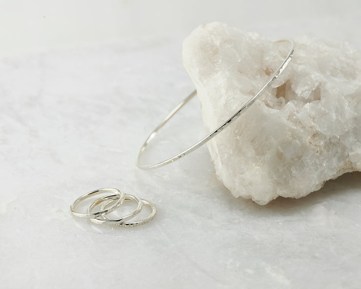 silver stacking rings and matching silver bangle