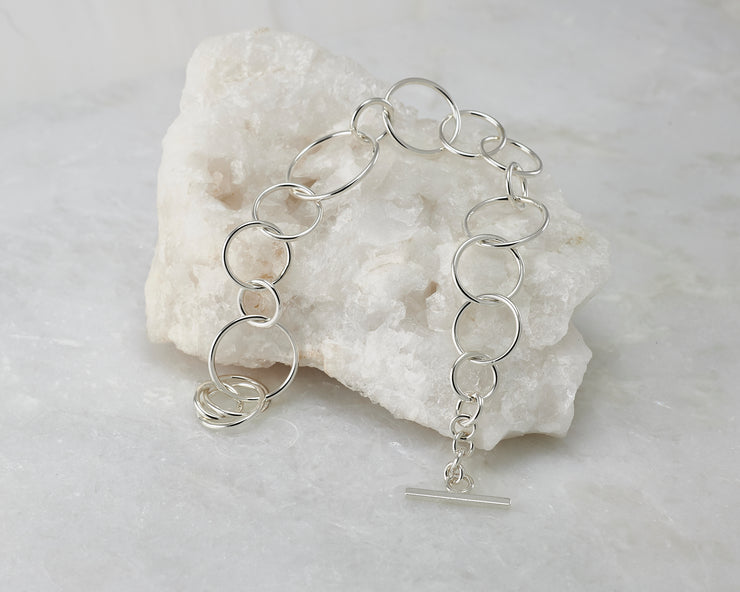 Silver chain link Bracelet on white rock