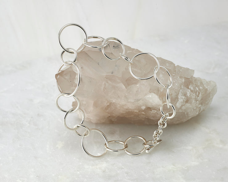 chain link latch bracelet shown closed on crystal rock