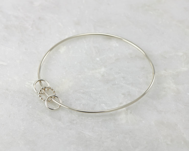 bangle charms silver bracelet on marble
