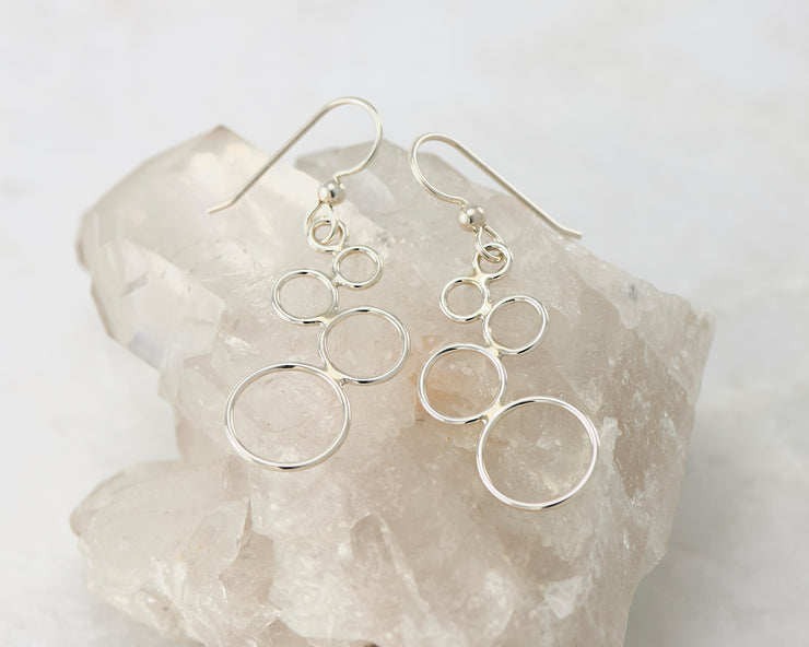 Silver circles chandelier earrings on crystal rock